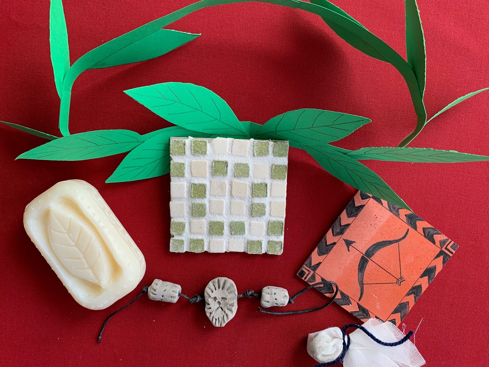 The projects inclue a soap carving, a mosaic tile, laurel wreath made of paper, a painted tile, a clay charm bracelet and a cloth medicine bag.