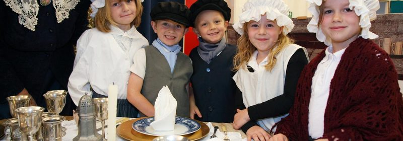 "Children learn to set a table as part of Off the Page's Victorian school workshop, ""Life In The Big House""."