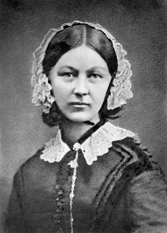 Florence Nightingale wears a lace collar and a lace headpiece.