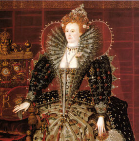 Sixty-six-year-old Queen Elizabeth I stands in a richly decorated dress with a high lace collar.