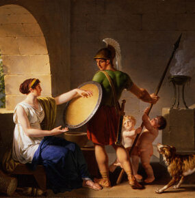 A young man in Spartan armour stands over his mother, who is giving him a round shield. Two young children play with the spear he is holding as a dog watches.