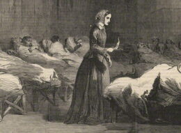 Florence Nightingale, holding a lamp in the darkness, checks on a ward full of patients at Scutari Hospital.