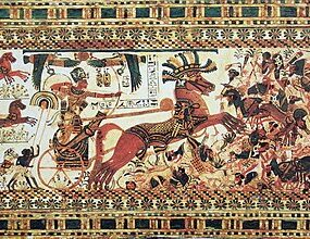 Tutankhamun rides a chariot and aims arrows at the enemies of Egypt.