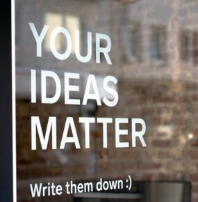 A sign states: Your ideas matter. Write them down.