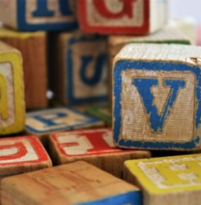 A colourful jumble of blocks with letters on them.